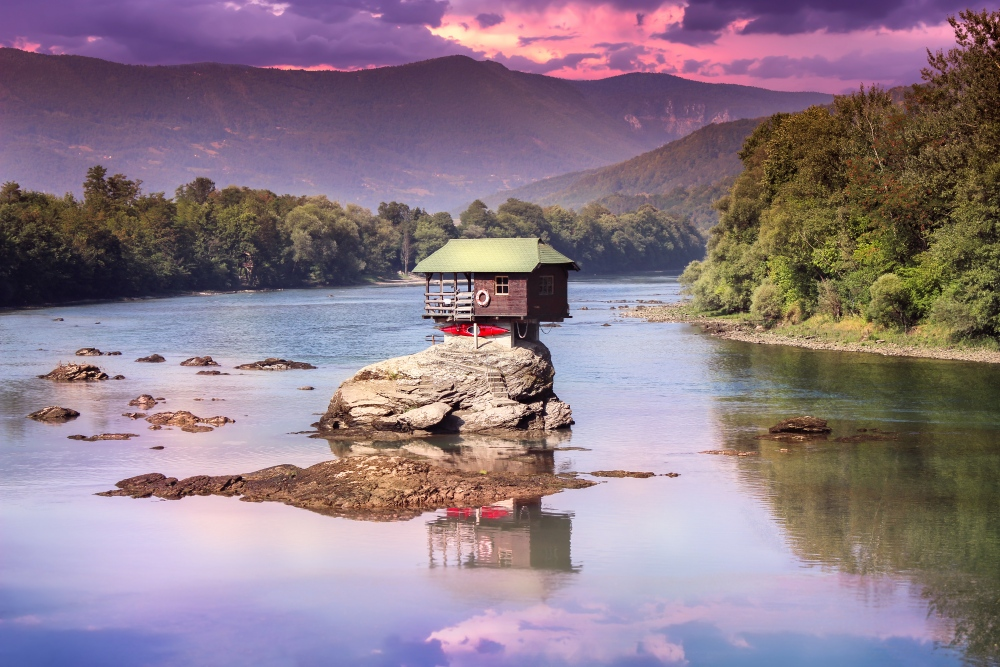 House perched in middle of river needs unique quote